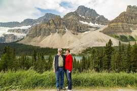 John and Jill Clardy at a scenic outlook on the Icefields Parkway, Crowfoot Glacier in Banff National Park.