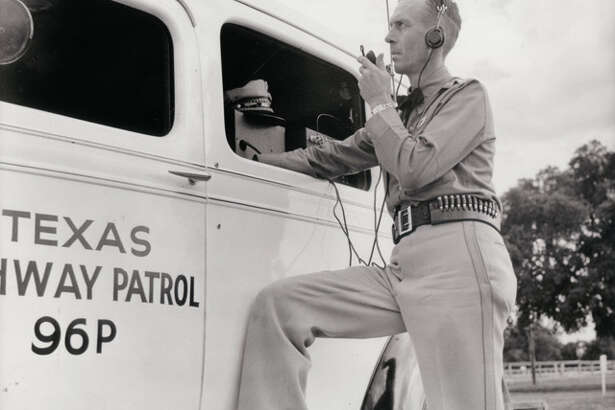 DPS trooper demonstrating mobile communications technology (circa 1940s).