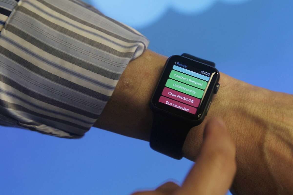 Skip Roncal, head of solutions consulting Vlocity, wears an Apple Watch displaying a Vlocity wear for communications and media app at an event announcing new workforce productivity apps for the Apple Watch at Salesforce on Tuesday, August 11, 2015 in San Francisco, Calif.
