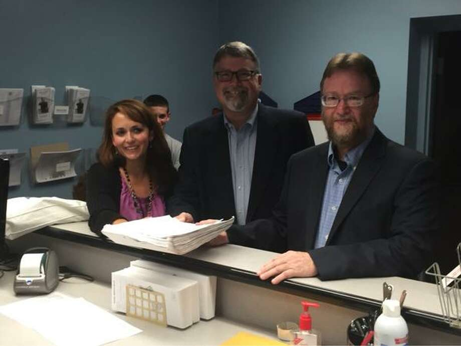 Candidates from the East Greenbush First party file petitions on Tuesday, Aug. 11, 2015, at the Rensselaer County Board of Elections in Troy. From left are Tina Tierney and Tom Grant, who are running for two open town board seats, and Jack Conway, who is running for town supervisor. (Kenneth C. Crowe II/Times Union)