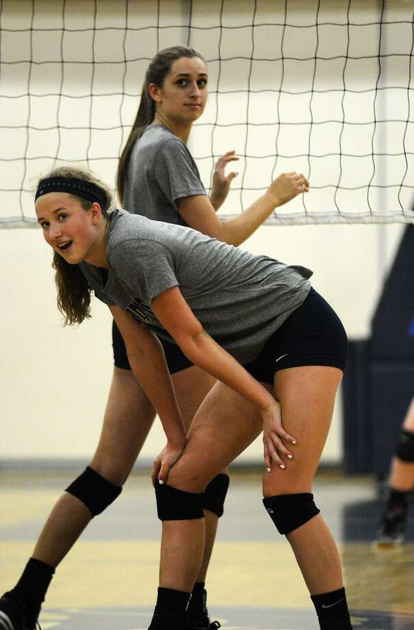 Second Baptist's Madeline DeJong, front, and Alyssa Aramburu  go to work against Episcopal at their volleyball tri-scrimmage with Houston Christian last week. Photo: Jerry Baker, Freelance