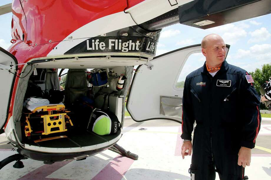 Flight nurse Donald Beebe shows a Life Flight helicopter at Memorial Hermann Southeast during a tour featuring the hospital's services. Southeast, which serves patients in Pearland and the Bay Area, is providing more types of specialized care such as are more often associated with the Texas Medical Center.  Flight nurse Donald Beebe shows a Life Flight helicopter at Memorial Hermann Southeast during a tour featuring the hospital's services. Southeast, which serves patients in Pearland and the Bay Area, is providing more types of specialized care such as are more often associated with the Texas Medical Center.  Flight nurse Donald Beebe shows a Life Flight helicopter at Memorial Hermann Southeast during a tour featuring the hospital's services. Southeast, which serves patients in Pearland and the Bay Area, is providing more types of specialized care such as are more often associated with the Texas Medical Center. Photo: Pin Lim, Freelance / Copyright Forest Photography, 2015.