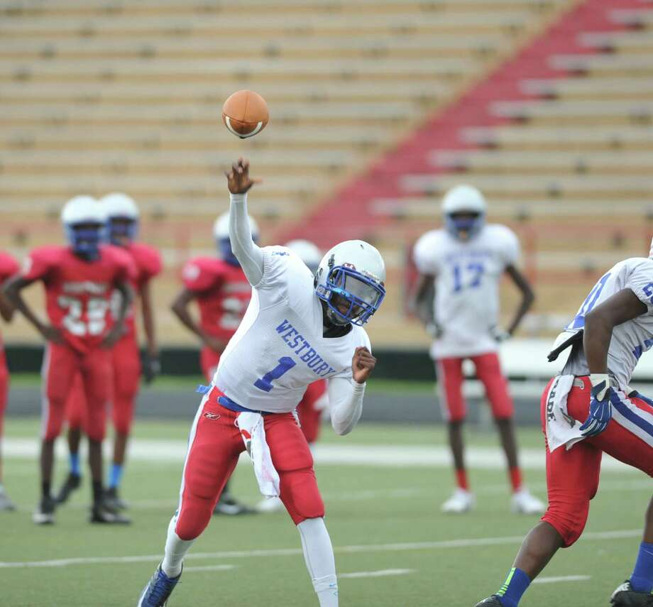 Westbury High School held its spring football scrimmage game, 5-21-2015. Roy Lewis (1) quarterback, throws to an open receiver. Photo: Eddy Matchette, Freelance / Freelance