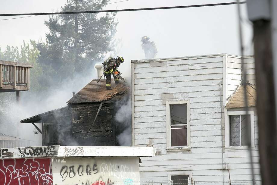 A fire in a residential building on the corner of 14th and Peralta, in West Oakland, on August 11 Photo: Nathan Weyland
