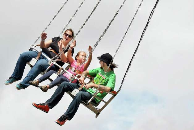 Lillyin Bailey, 6, of Guilderland rides the SkyHawk with mom, Meagan Bailey,  and dad, Bradley Roundy-Ferris, during Tuesday's opening day of the  Altamont Fair.  (John Carl D'Annibale / Times Union) Photo: John Carl D'Annibale / 10032906A