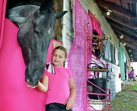 Hannah Bishop, 7, of Pattersonville and her horse Stormy Night at the Altamont Fair on Tuesday. (John Carl D'Annibale / Times Union) Photo: John Carl D'Annibale / 10032906A