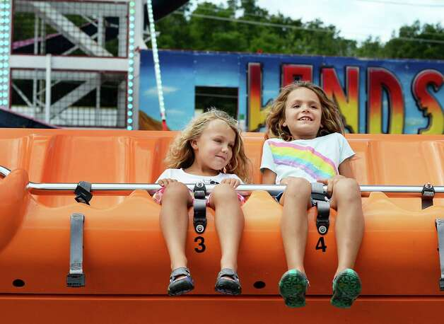 Sisters Reed and Violet McCutcheon of Altamont ride the Happy Swing on Tuesday at the Altamont Fair.  (John Carl D'Annibale / Times Union) Photo: John Carl D'Annibale / 10032906A
