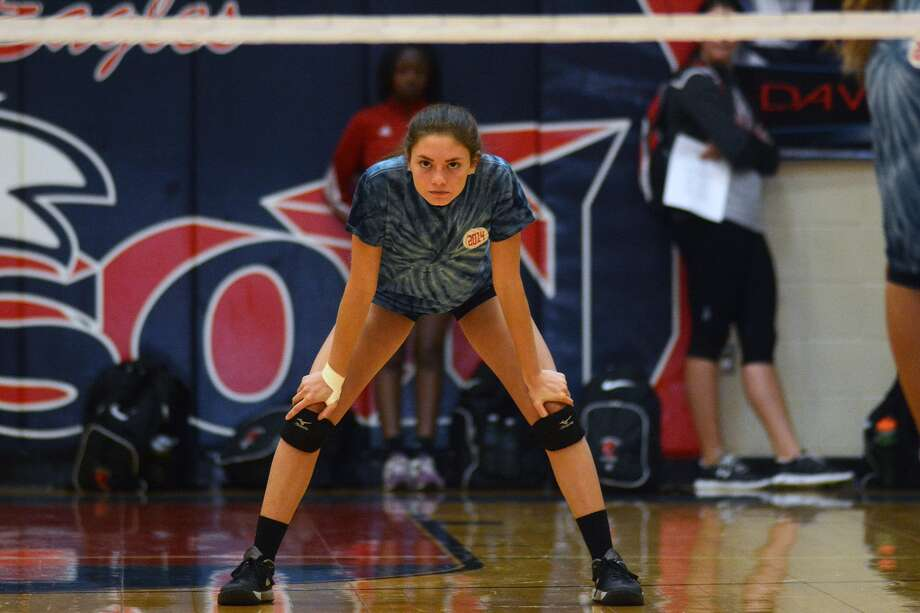 Pearland Dawson sophomore defensive specialist Marisabel Torres puts her game face on against Texas City during their scrimmage at Dawson High School on Aug. 8, 2015. (Photo by Jerry Baker/Freelance) Photo: Jerry Baker, Freelance