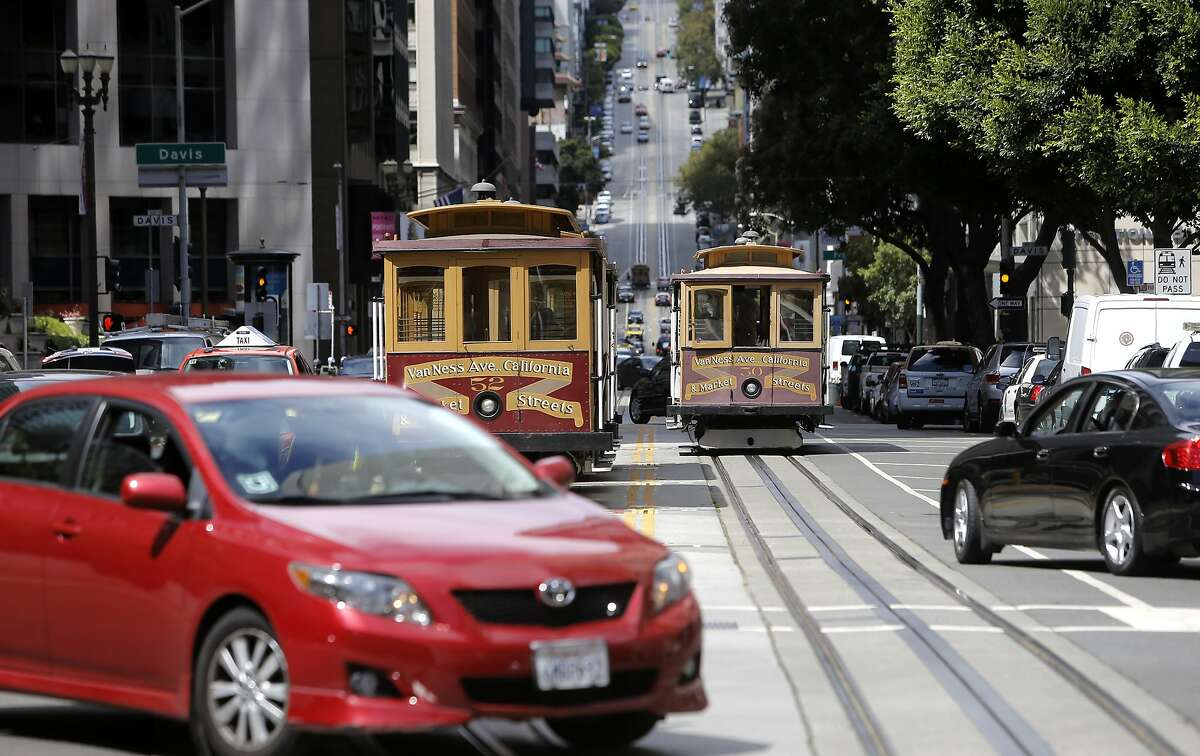 Cable cars along California St. as the members of the Transport Workers Union 250A, the San Francisco Municipal Transit Agency and the San Francisco Police department, announced key steps to keep operators and passengers safe on cable cars, during a press conference at the foot of California Street in San Francisco, Calif., on Tues. August 11, 2015.