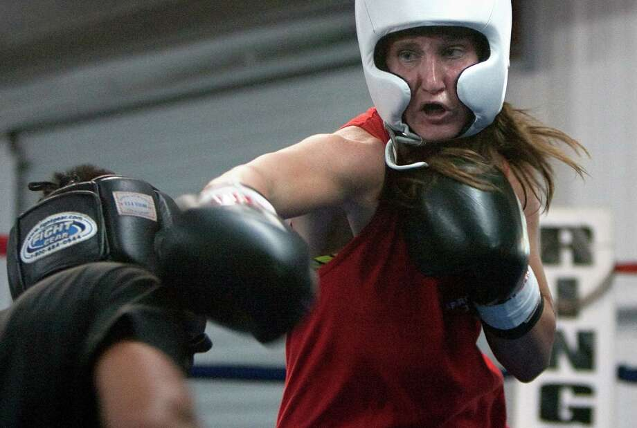After earning a National Golden Gloves flyweight title, Virginia Fuchs is hoping finally to get past nemesis Marlen Esparza at the Olympic Trials in Memphis, Tenn., this October. Photo: Cody Duty, Staff / © 2011 Houston Chronicle