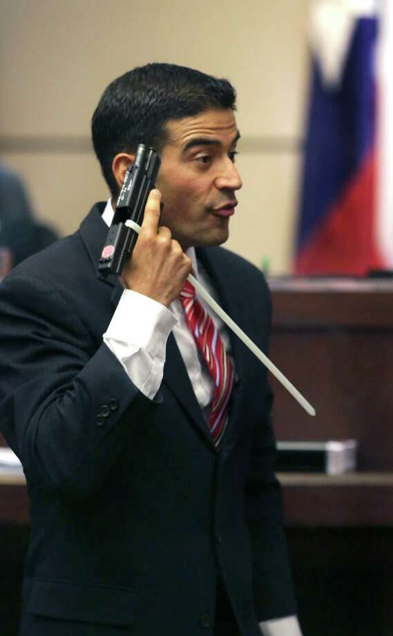 Bexar County District Attorney Nicholas LaHood using a piece of evidence, makes closing arguments in the 437th State District Court, in the case against Jessie Hernandez Jr. on Tuesday, August 11, 2015, who is accused of shooting two police officers. Photo: Bob Owen, San Antonio Express-News / San Antonio Express-News