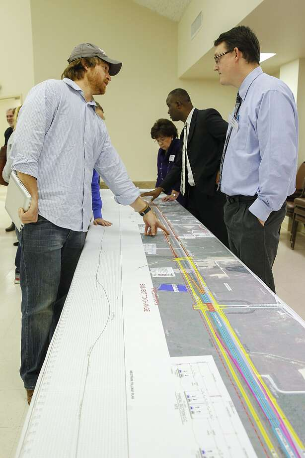 Eric Hauls of Fulshear discusses improvements and widening of FM 1093 and the Westpark Tollway into Fulshear with Matt Estes of Klotz Associates at a Dec. 9, 2014, open house of the TxDOT Houston District, in partnership with Fort Bend County at the Stern Community Center in Fulshear.Eric Hauls of Fulshear discusses improvements and widening of FM 1093 and the Westpark Tollway into Fulshear with Matt Estes of Klotz Associates at a Dec. 9, 2014, open house of the TxDOT Houston District, in partnership with Fort Bend County at the Stern Community Center in Fulshear. Photo: Diana L. Porter, Freelance / © Diana L. Porter