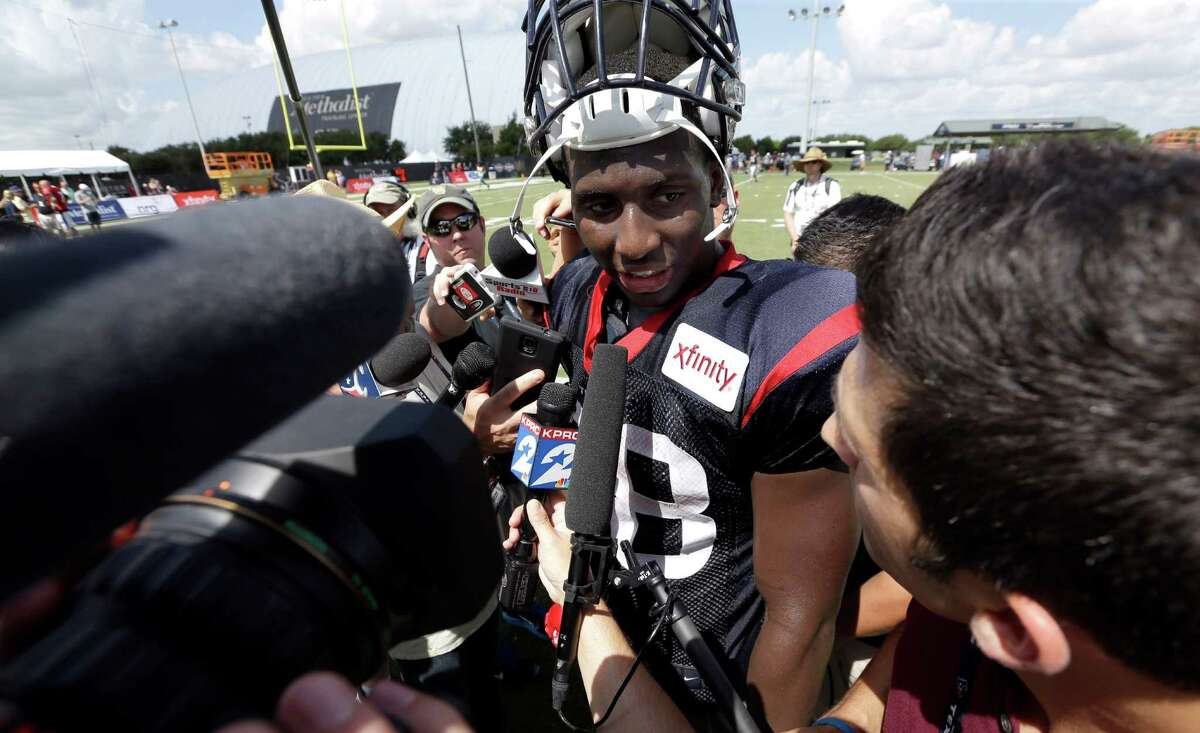 Houston Texans running back Alfred Blue talks with the media after an NFL football training camp practice in Houston on Aug. 5, 2015. Alfred Blue had a solid rookie season in 2014 backing up Arian Foster. Now that Foster is out indefinitely with a groin injury, Blue will be thrust into a starting role and forced to carry Houston's running game.