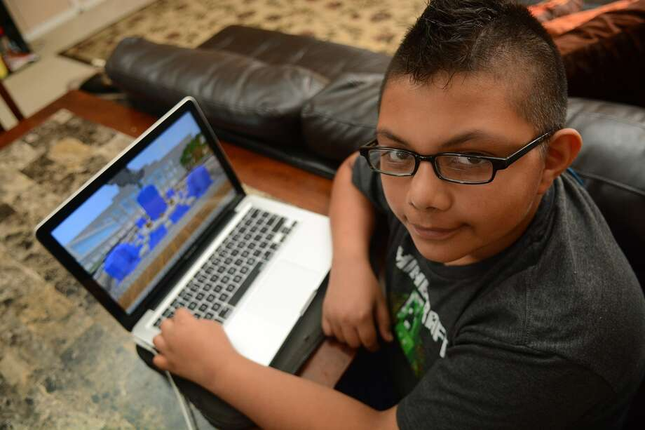 Mathew Varela, 11, a 6th grader at Cox Inter., works on his Minecraft skills at his family's Spring home on Friday, July 31, 2015. (Photo by Jerry Baker/Freelance) Photo: Jerry Baker, Freelance