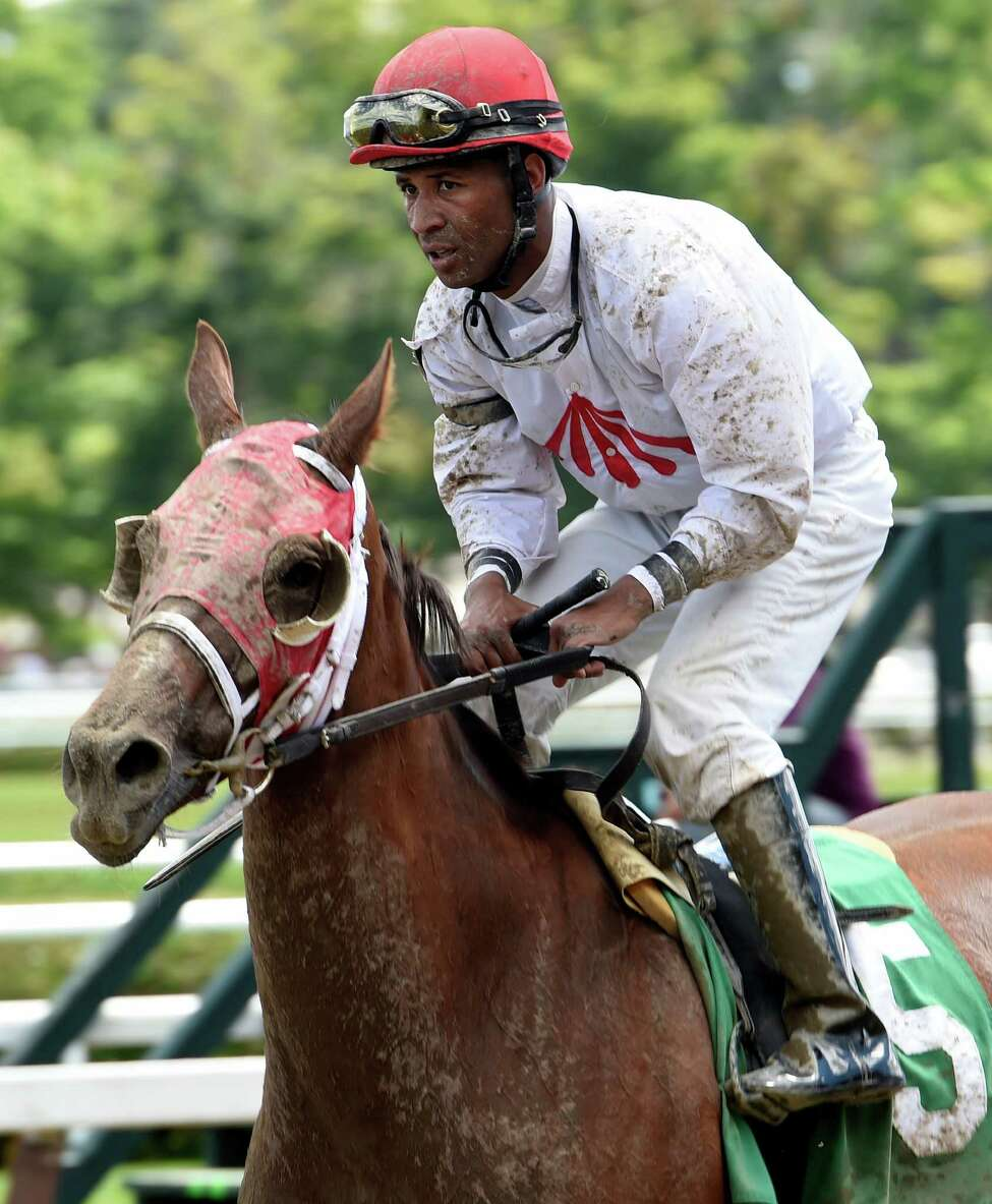 Jockey Kendrick Carmouche rides back to the finish line to unsaddle after a race at the Saratoga Race Course Thursday Aug. 6, 2015 (Skip Dickstein/Times Union)
