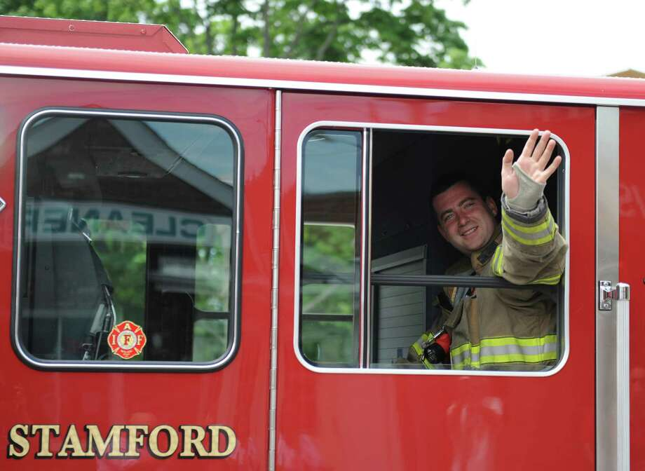 Photos from the annual Memorial Day Parade in Stamford, Conn. Sunday, May 24, 2015.  The parade was led by the Stamford Fire Department Honor Guard and featured WWII Iwo Jima survivor John S. Geas as the Grand Marshal.  The parade concluded with a ceremony at Veteran's Park to remember those who lost their lives in combat. Photo: Tyler Sizemore / Hearst Connecticut Media / Greenwich Time