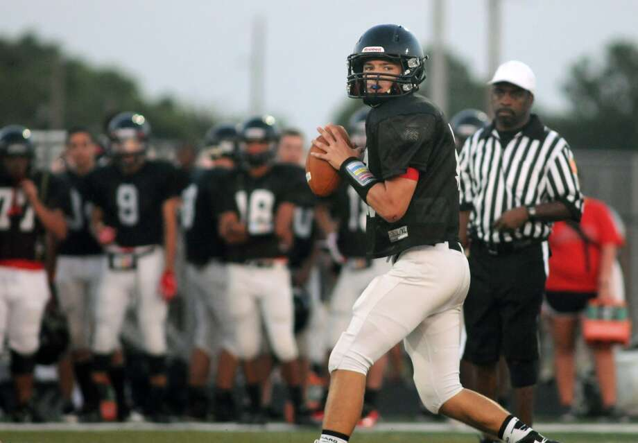 Porter quarterback Jake Hall is back this fall to lead the Spartans, who are hoping to compete for a playoff berth. Photo: Jerry Baker, Freelance