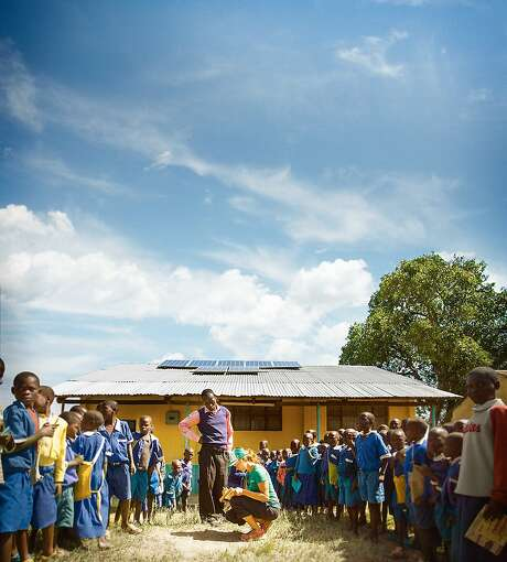 SolarCity's Alex Webster helps install solar panels at a school in Kenya, work of the company's charity. Photo: SolarCity