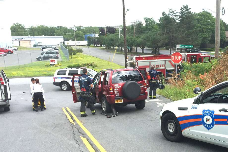 A Jeep being chased by Albany police broadsided another vehicle on Tuesday, Aug. 11, 2015, at North Manning Boulevard in Albany. Two women in the struck vehicle were treated at the scene by Albany Fire Paramedics and taken to a hospital.  (Tom Heffernan Sr./Special to the Times Union) Photo: Picasa