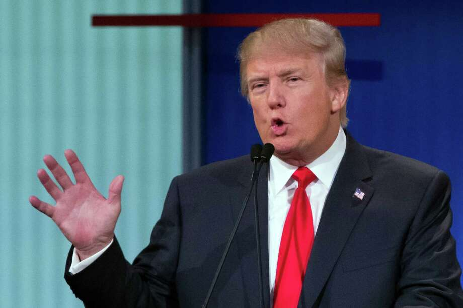 """In this Thursday, Aug. 6, 2015 photo, republican presidential candidate Donald Trump participates in the first Republican presidential debate at the Quicken Loans Arena, in Cleveland. Angry over what he considered unfair treatment at the debate, Trump told CNN on Friday night that Fox News moderator Megyn Kelly had """"blood coming out of her eyes, blood coming out of her wherever."""" (AP Photo/John Minchillo) Photo: John Minchillo, STF / Associated Press / AP"""