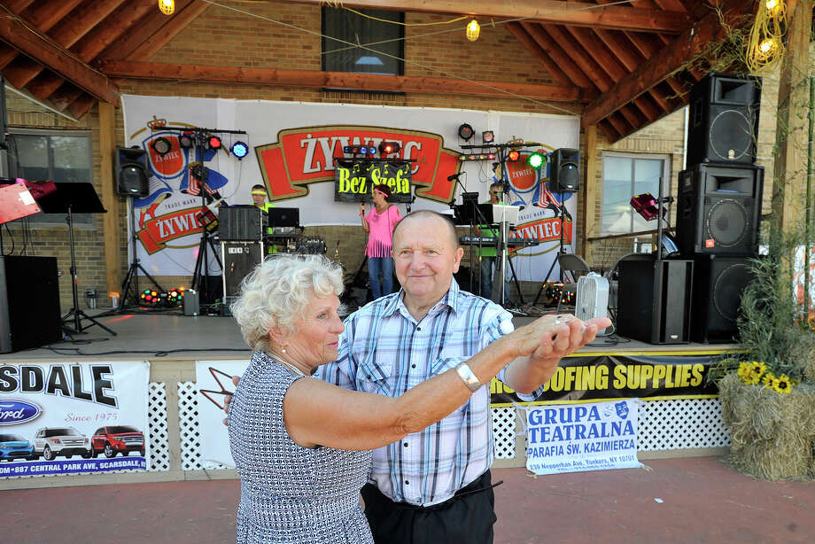 Aleks Rozak dances with Yadwiga Kopacz to the sounds of the band Bez Szefa during the 36th annual Polish Harvest Festival at Holy Name of Jesus Church in Stamford, Conn., on Sunday, Aug. 17, 2014. Photo: Jason Rearick / Jason Rearick / Stamford Advocate