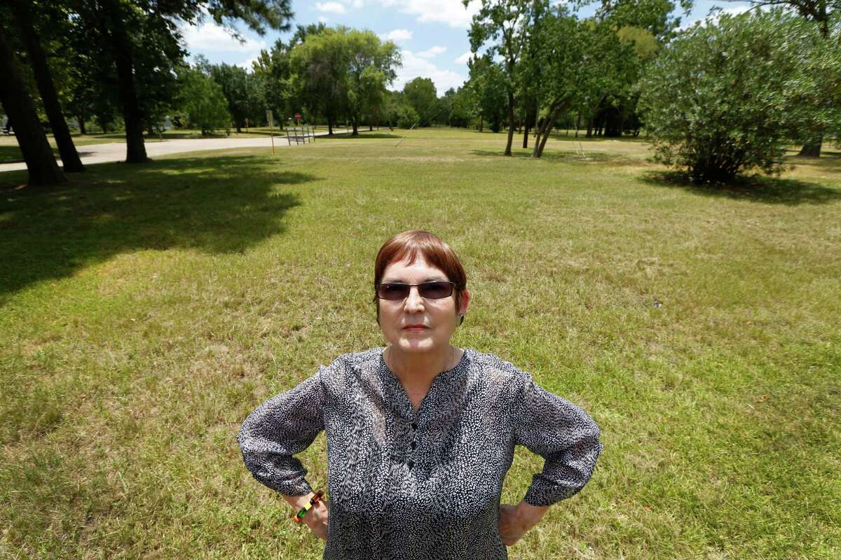 Sheila Wyborny stands in an empty field that she used to call home in the Creekside Estates Friday, Aug. 7, 2015, in Houston. Sheila and her husband Wendell Wyborny had their home flooded in rain events in 1998, 2001 and 2002. The county's flood control ultimately bought them out and their land is empty. Friday, Aug. 7, 2015, in Houston.