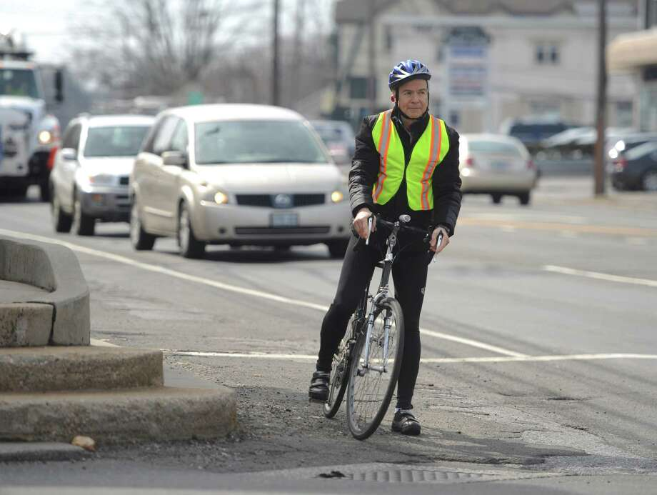 Stamford resident Jerry Silber, founder of People Friendly Stamford, rides his bike along High Ridge Road in Stamford, Conn. Monday, April 6, 2015.  People Friendly Stamford's mission is to connect Stamford's neighborhoods in a way that is safe for both cyclists and pedestrians, particularly by creating bike lanes throughout town. Photo: Tyler Sizemore / Tyler Sizemore / Stamford Advocate