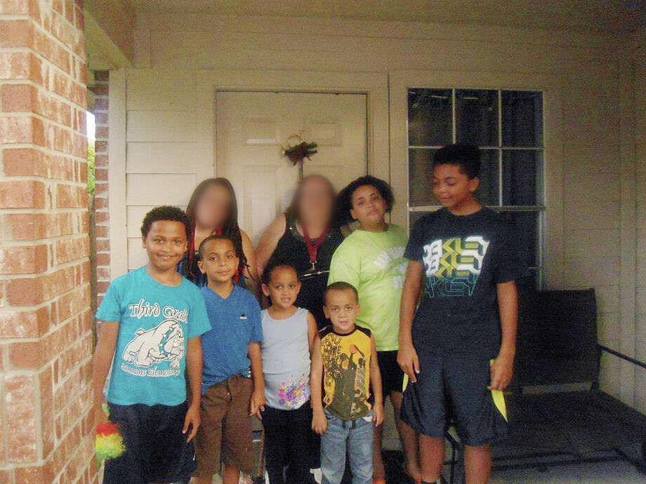 An undated photo of the six children killed a recent massacre in northwest Harris County was posted on a gofundme page set up for the family. The family did not want two of the family members in the people in photo identified and their faces have been intentionally blurred. They were not harmed. The children are, from left to right: Dwayne Jackson, Jr., 10; Caleb Jackson, 9; Trinity Jackson, 7; Jonah Jackson, 6; Honesty Jackson, 11; and Nathaniel Conley, 11. Photo: Family