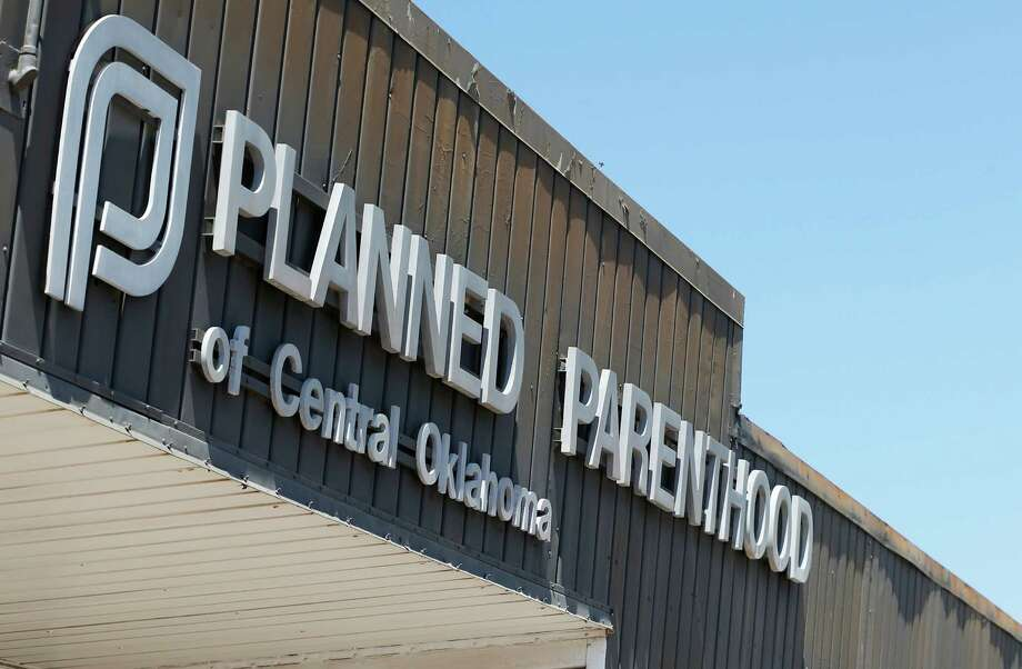 FILE - In this July 24, 2015, file photo, a sign at a Planned Parenthood Clinic is pictured in Oklahoma City. The furor on Capitol Hill over Planned Parenthood has stoked a debate about the use of tissue from aborted fetuses in medical research, but U.S. scientists have been using such cells for decades to develop vaccines and seek treatments for a host of ailments, from vision loss and neurological disorders to cancer and AIDS. (AP Photo/Sue Ogrocki, File) Photo: Sue Ogrocki, STF / AP