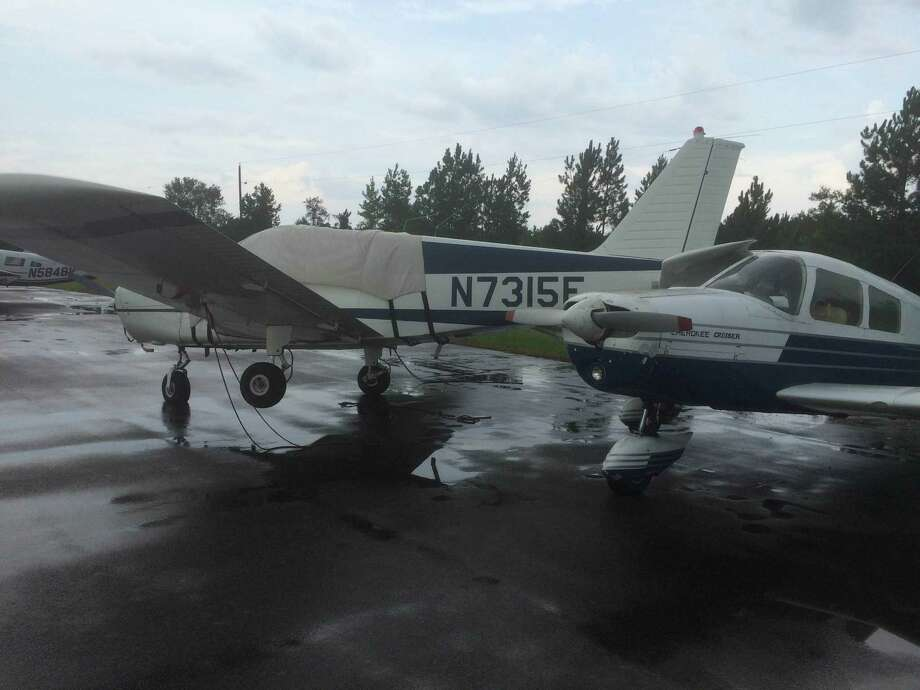 Five privately owned planes at the Hardin County Airport at Hawthorne Field in Kountze were damaged when strong winds from a thunderstorm pushed through the area on Tuesday afternoon.  Photo taken on Aug. 11, 2015.