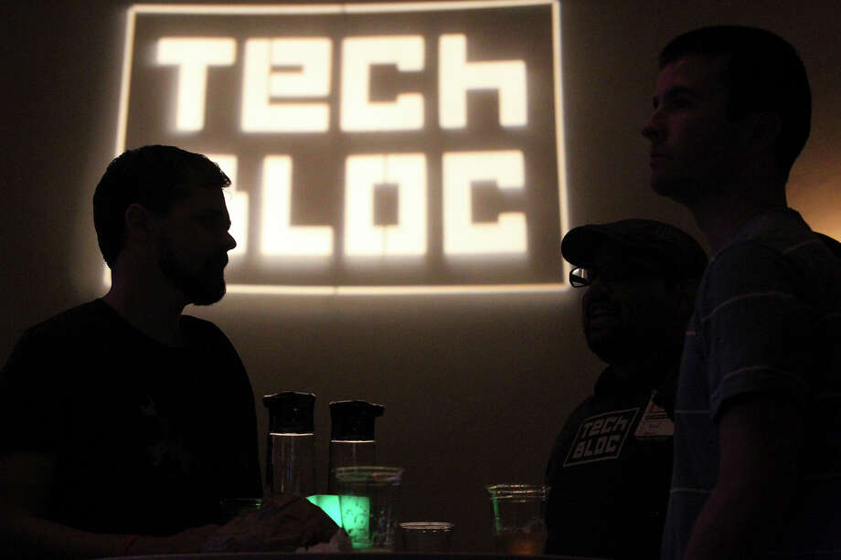 Attendees visit Tuesday while waiting for the speakers at the Tech Bloc event at the Pearl Stables. Photo: Tom Reel /San Antonio Express-News