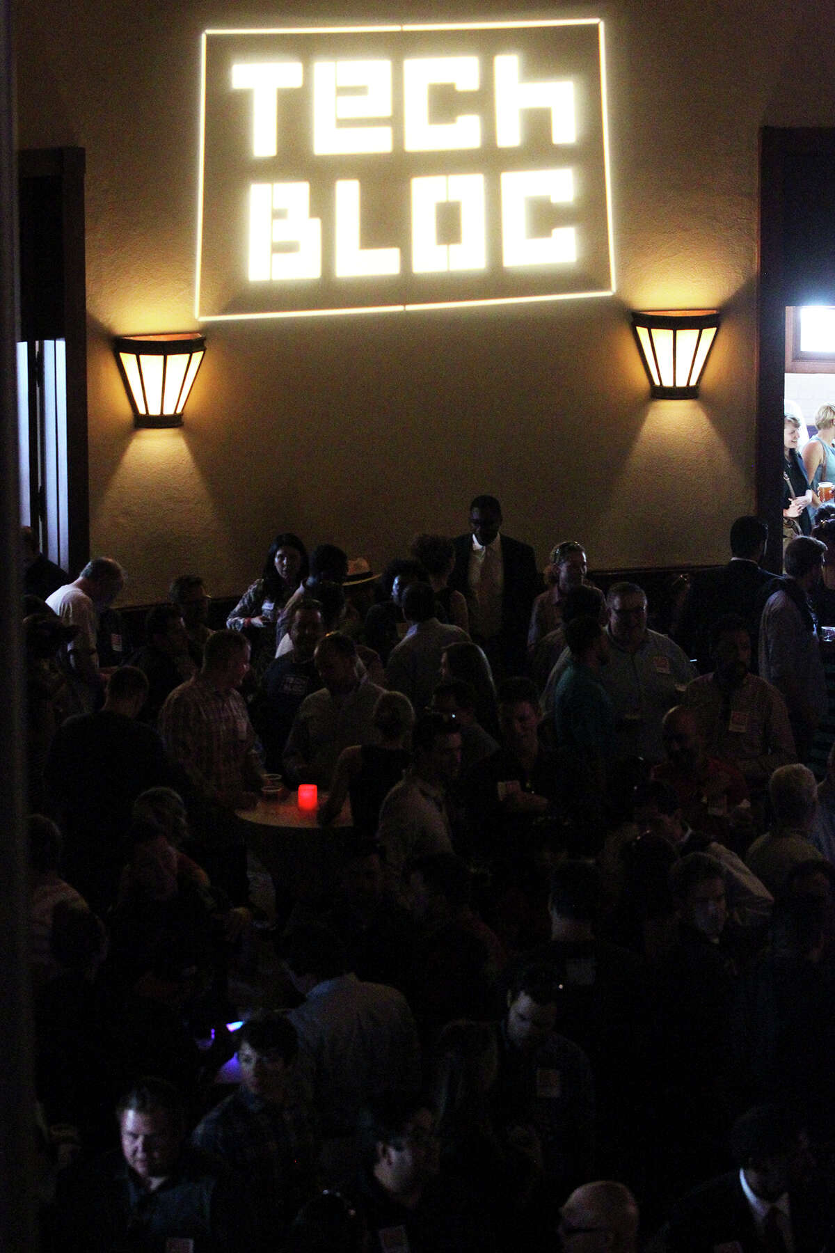 Crowds gather at the Tech Bloc event at the Pearl Stables.