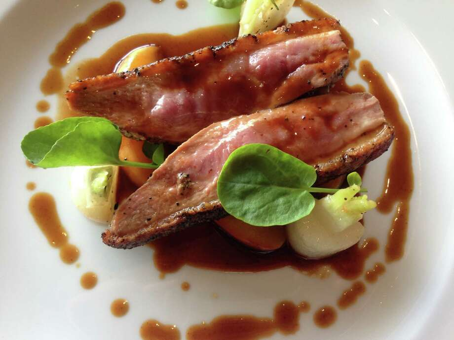 Roasted duck with Texas peaches at Table on Post Oak. Photo: Greg Morago