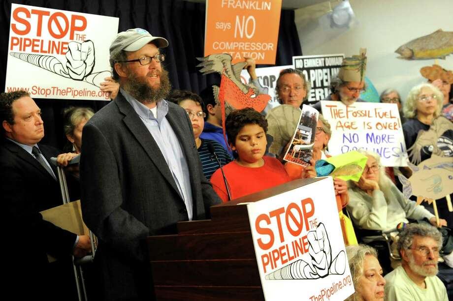 Wes Gillingham, program director of Catskill Mountainkeeper, center, speaks during a news conference to call on the DEC to stop the Constitution gas pipeline on Tuesday, Aug. 11, 2015, at the Legislative Office Building in Albany, N.Y. (Cindy Schultz / Times Union) Photo: Cindy Schultz / 00032960A