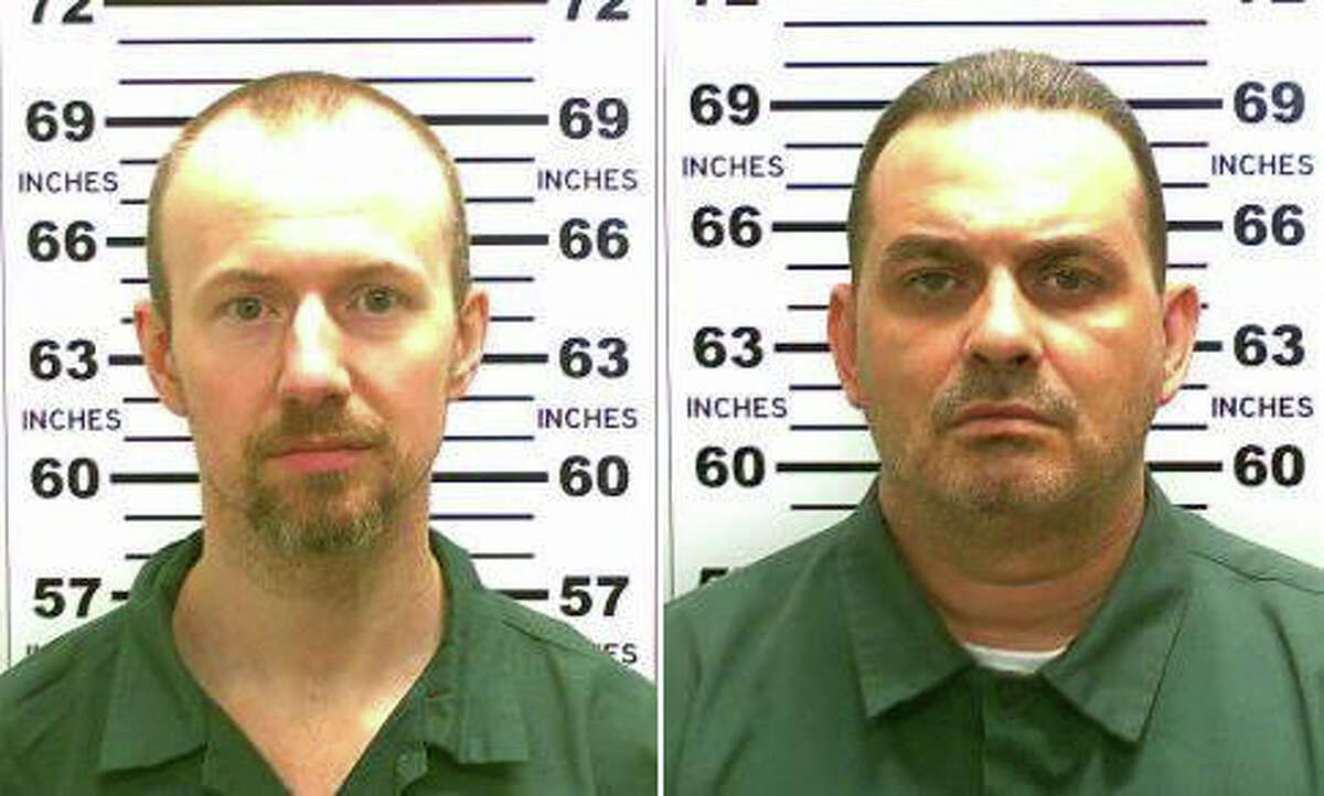 FILE - At left, in a May 21, 2015, file photo released by the New York State Police is David Sweat. At right, in a May 20, 2015, file photo released by the New York State Police is Richard Matt. New York State Police are investigating a possible sighting of the two convicted killers who escaped from an upstate New York prison two weeks ago. In a news release posted late Friday, June 19, 2015, State Police say two men fitting the description of inmates David Sweat and Richard Matt were seen a week ago in Steuben County, New York, over 300 miles southwest of the prison in Dannemora. (New York State Police via AP, File) ORG XMIT: NY107