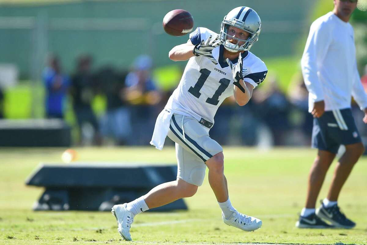 Dallas Cowboys wide receiver Cole Beasley makes a catch during a drill at Dallas Cowboys' NFL training camp, Tuesday, Aug. 4, 2015, in Oxnard, Calif.