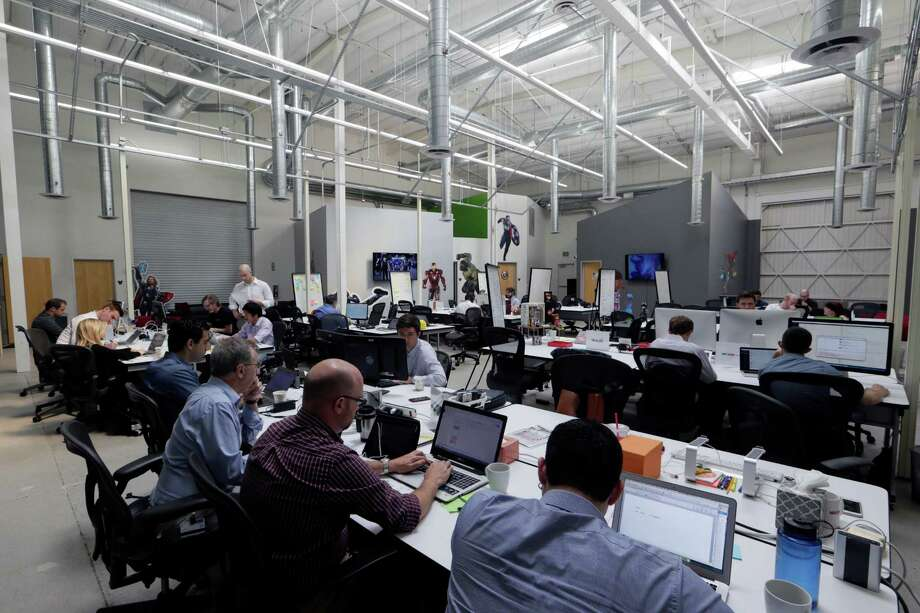 """In this Monday, July 13, 2015, photo, members of Disney's """"accelerator"""" class of ten startup companies work at Disney's accelerator space in Glendale, Calif. The mentorship and investment program, designed for media and entertainment technology startups, provides each company up to a $120,000 investment and 15 weeks to incubate their ideas from Disney's mentors and networks. (AP Photo/Damian Dovarganes) Photo: Damian Dovarganes, STF / Associated Press / AP"""