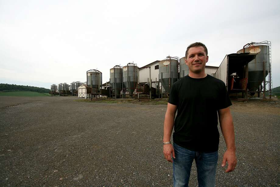 Dennis Brubaker stands on his pig farm in Beavertown, Pennsylvania. Photo: Pauline Bartolone/CALmatters
