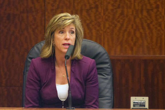 Kelly Siegler testifies during a hearing for a possible retrial for David Temple at the Ceremonial Courtroom at the Harris County Criminal Courthouse, Dec. 22, 2014, in Houston.