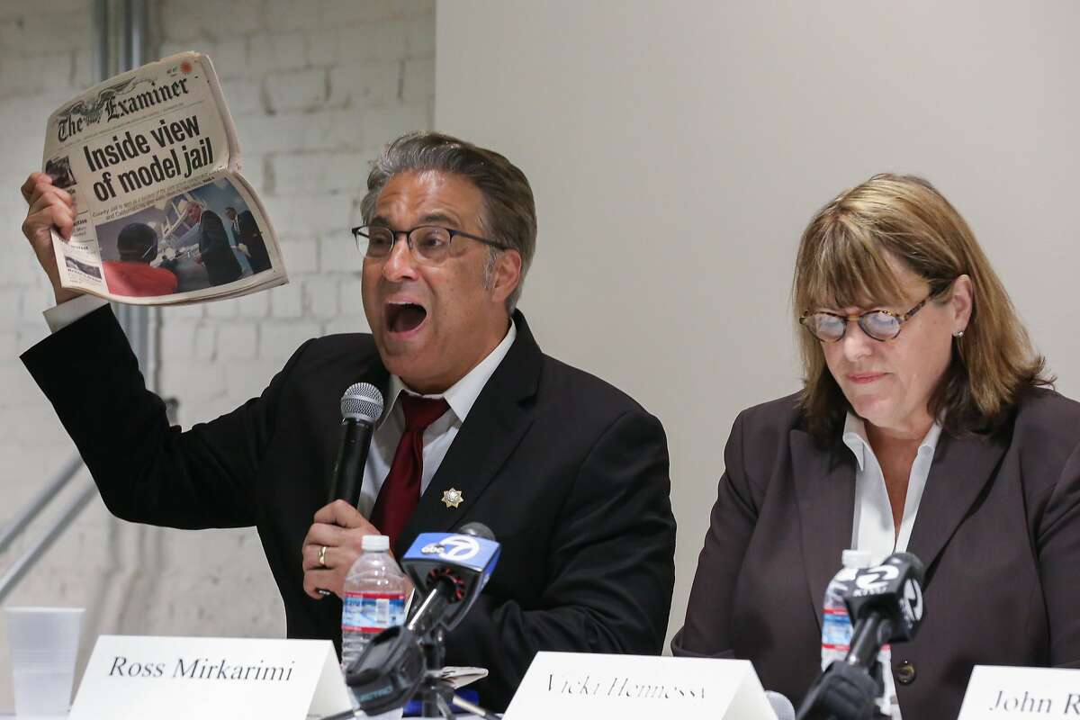 Sheriff Ross Mirkarimi displays an article regarding San Francisco County jail as a model jail for prison realignment ,claiming credit as why he should be reelected sheriff during the debate at Zendesk on Tuesday, August 11, 2015 in San Francisco, Calif.