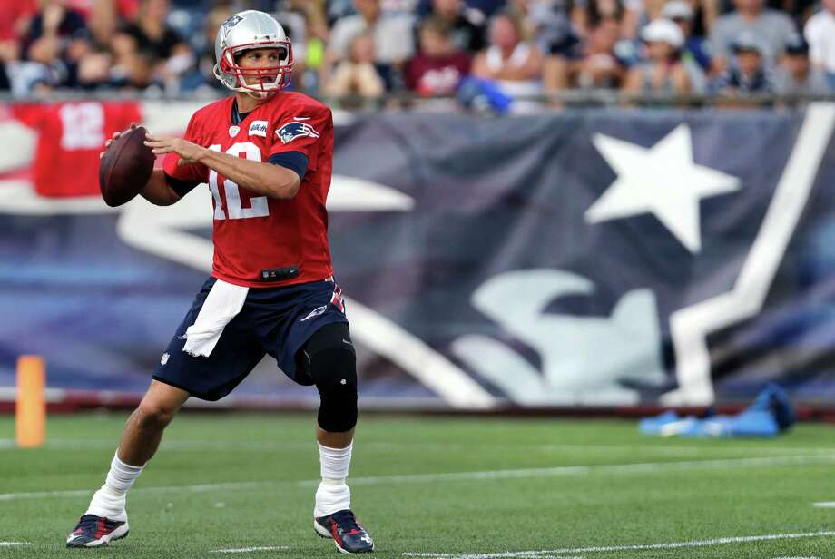 New England Patriots quarterback Tom Brady sets to pass during NFL football training camp in Foxborough, Mass., Wednesday, Aug. 5, 2015. (AP Photo/Charles Krupa) ORG XMIT: MACK109 Photo: Charles Krupa / AP