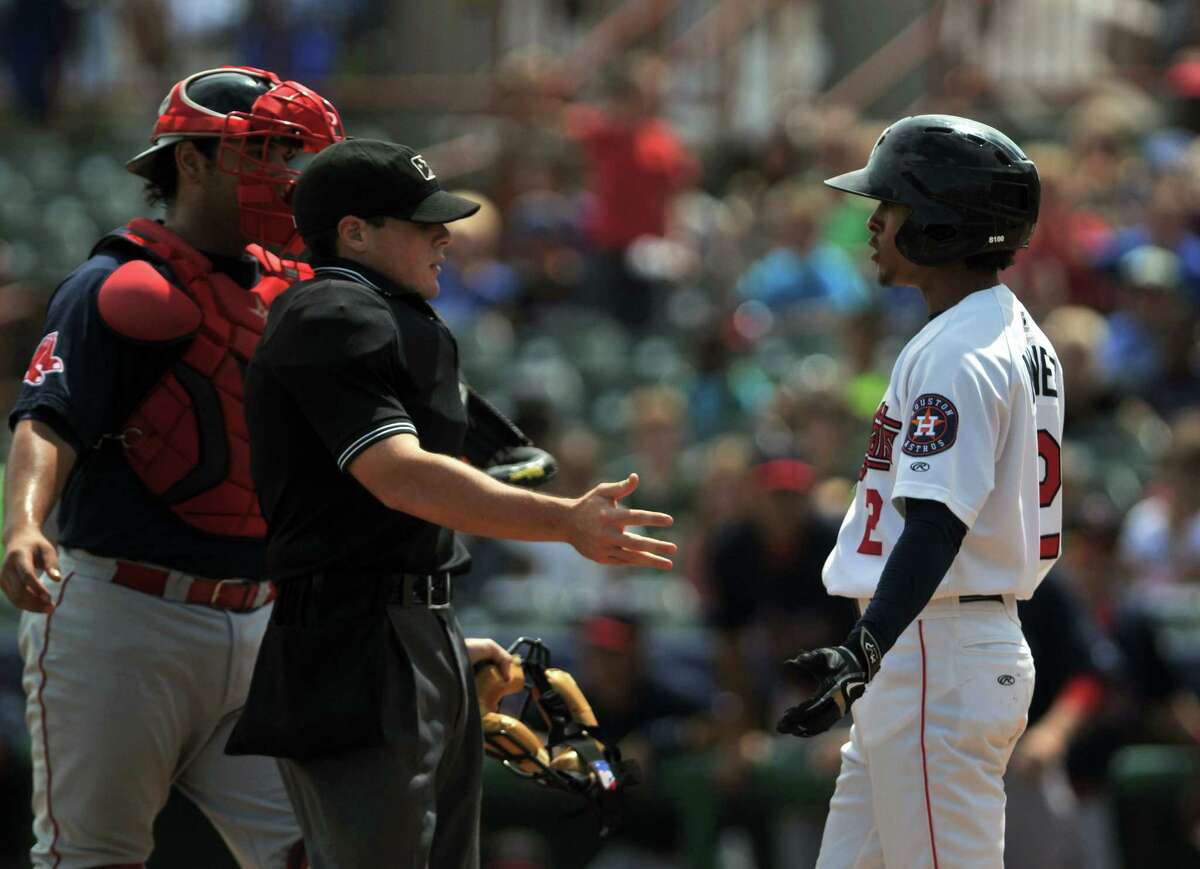 An umpire breaks up a disagreement between ValleyCat's Antonio Nunez, right, and Lowell Spinner's Alixon Suarez during a game on Tuesday, Aug 11, 2015, at Joe Bruno Stadium in Troy, N.Y. (Phoebe Sheehan/Special to The Times Union)