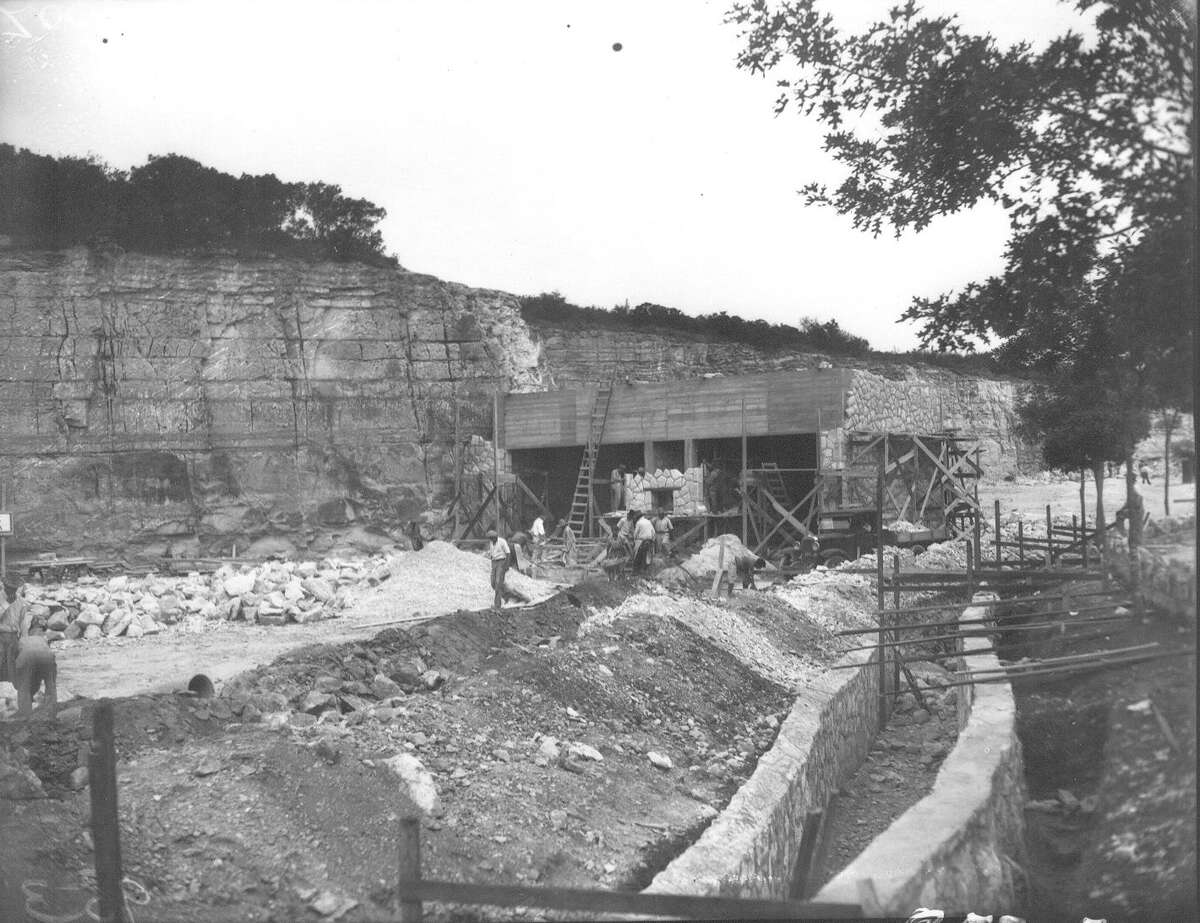 The elephant pit at the San Antonio Zoo is shown under construction. The high rock walls can be seen in the background. Photo published in the Light, May 13, 1936.