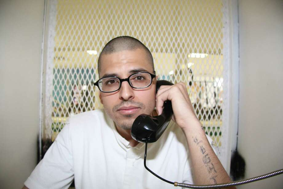 In this Aug. 5, 2015 photo, Daniel Lee Lopez, 27, speaks from a visiting cage outside death row at the Texas Department of Criminal Justice Polunsky Unit near Livingston, Texas. Photo: Michael Graczyk /Associated Press / AP