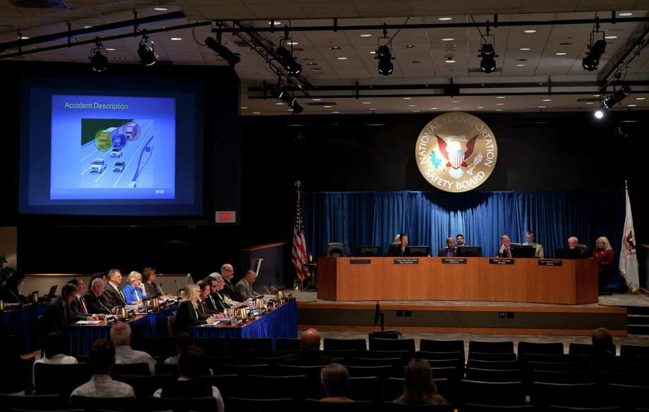 An accident description is displayed on a large screen  as the National Transportation Safety Board (NTSB) meets at their headquarters in Washington, Tuesday, Aug. 11, 2015, to determine the cause of an accident last year that severely injured comedian Tracy Morgan and killed another comedian after a truck smashed into their limousine during a traffic backup on the New Jersey Turnpike. (AP Photo/Carolyn Kaster) Photo: Carolyn Kaster, STF / Associated Press / AP