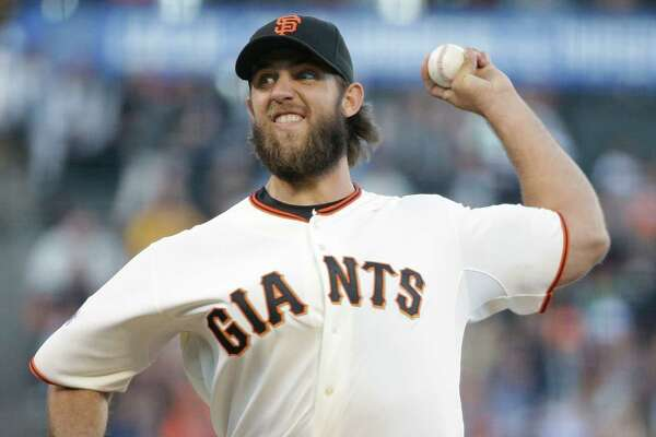 San Francisco Giants starting pitcher Madison Bumgarner throws in the first inning of their baseball game against the Houston Astros Tuesday, Aug. 11, 2015, in San Francisco. (AP Photo/Eric Risberg)