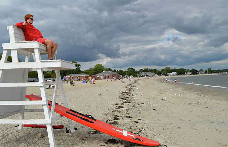 An end-of-summer scene at Compo Beach last year. Beach crowds -- and lifeguard staffing -- are again on the decline as Labor Day approaches. Photo: File Photo / File Photo / Westport News