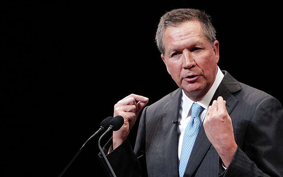 "Ohio Gov. John Kasich, according to columnist Woody Klein, in the first GOP presidential debate ""pulled a major upset by emerging as a surprising standout on his home ground in Cleveland."" Photo: Associated Press / Associated Press / Westport News"