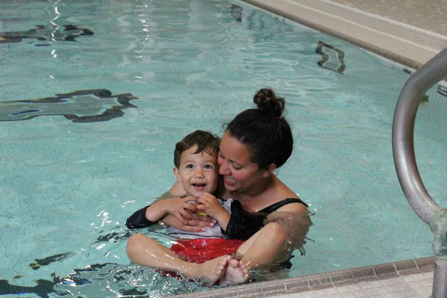 Jennifer and Anthony DeMattia take swim lessons together at the New Canaan YMCA. Photo: Contributed / Contributed Photo / New Canaan News