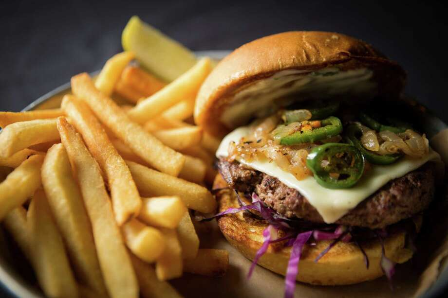 The folks at Alamo Drafthouse hope the Torch Burger will ignite some interest in Houston Restaurant Weeks and the mission of the Houston Food Bank. Photo: Marie D. De Jesus, Staff / © 2015 Houston Chronicle